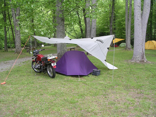 Benefits are reduced or eliminated dew on the tent; easy access to tent if its raining to keep water from streaming in; sometimes enough room to get the ... & Tarp / gear cover when camping - got pics? | Adventure Rider